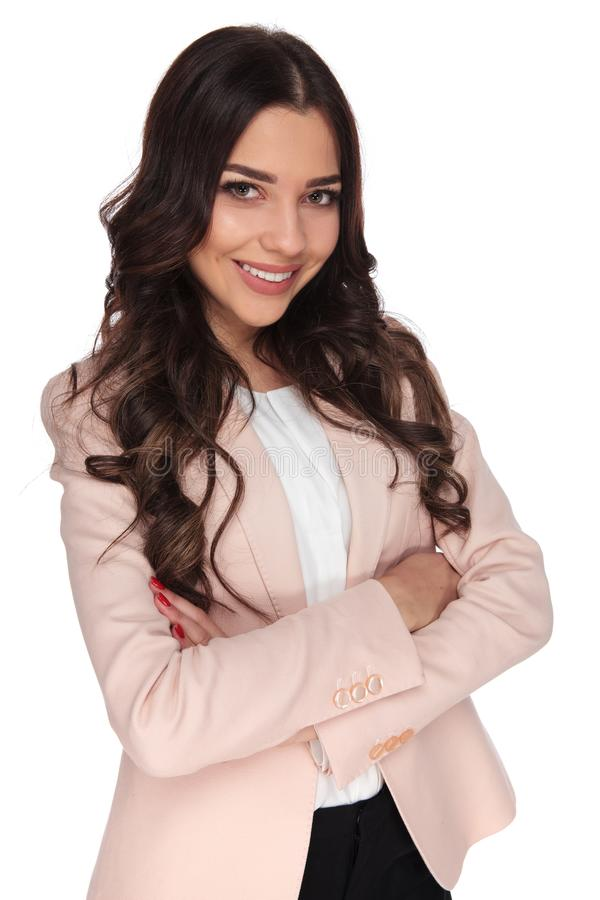 Confident young business woman with hands crossed is smiling royalty free stock photos
