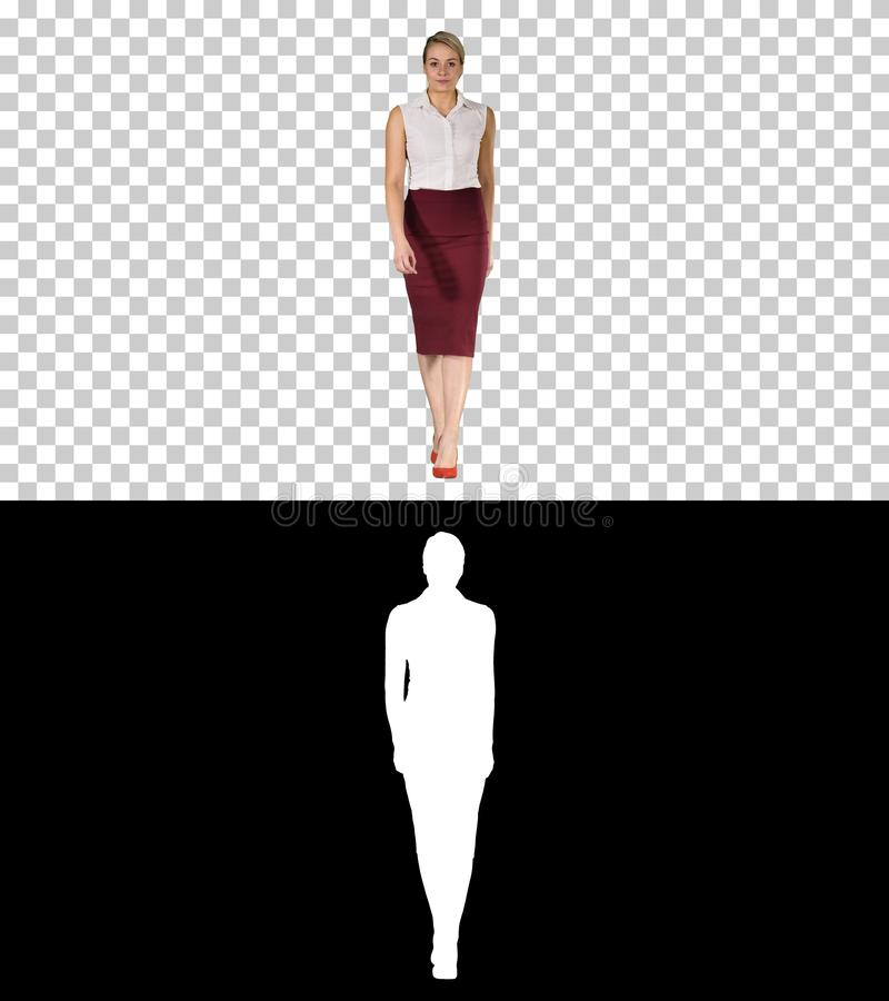 Confident young business woman walking, Alpha Channel stock photography