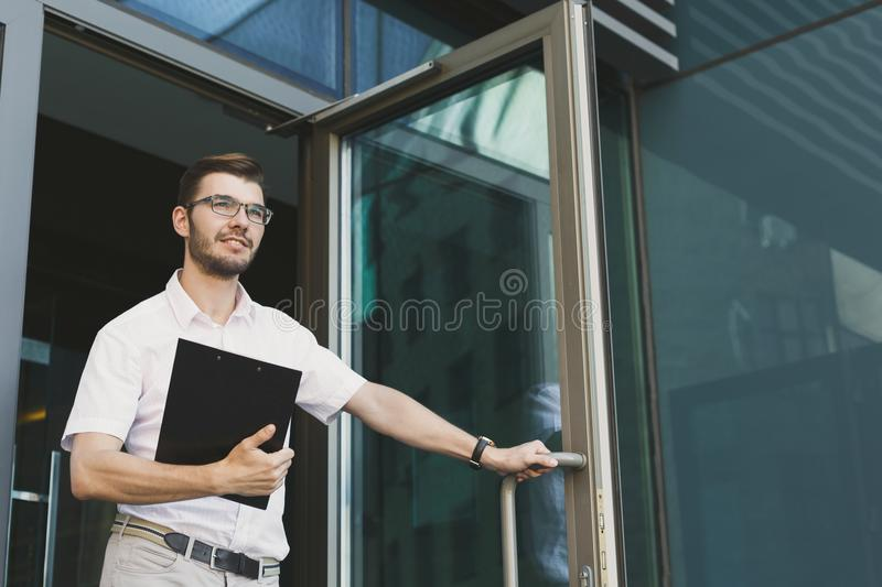 Confident young businessman at business center royalty free stock image