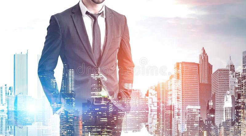 Confident young businessman in modern city stock photo