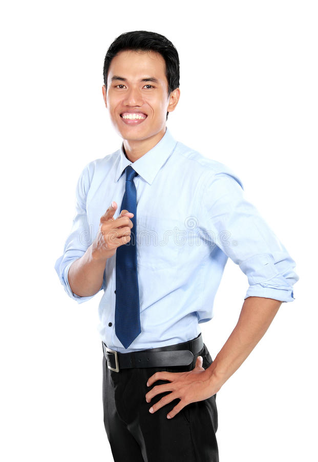 Confident young businessman pointing at you stock photography