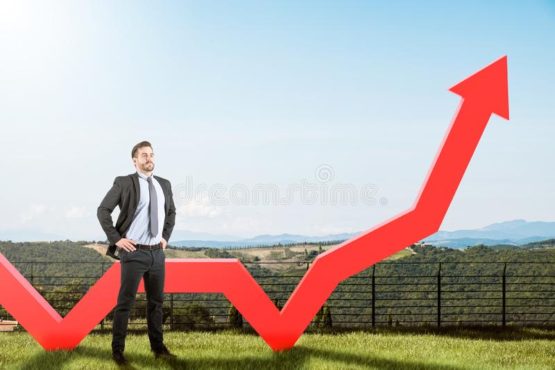Confident businessman and growing graph royalty free stock photo