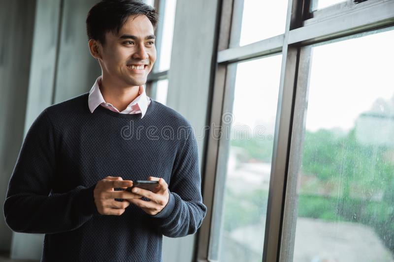 Confident young businessman using cell phone stock images