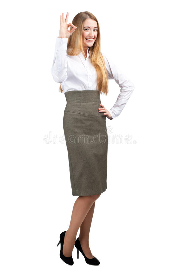 Confident Young Businesswoman Showing OK Sign Stock Photo