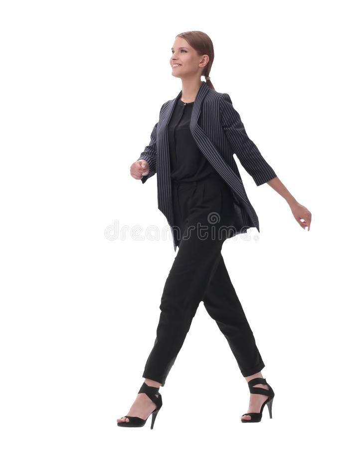 Confident young businesswoman stepping forward. isolated on white background. In full growth. confident young businesswoman stepping forward. isolated on white royalty free stock images