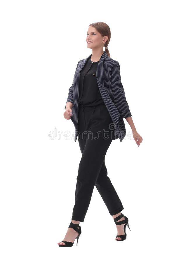 Confident young businesswoman stepping forward. isolated on white background. In full growth. confident young businesswoman stepping forward. isolated on white stock photo