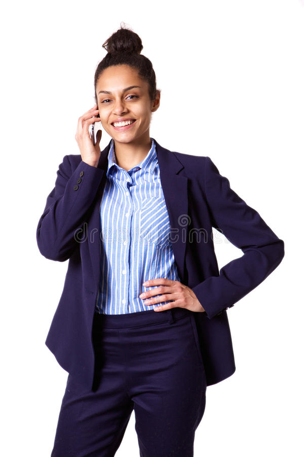 Confident young businesswoman talking on mobile phone royalty free stock photo