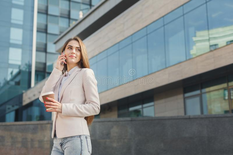 Confident young businesswoman talking on mobile stock photos