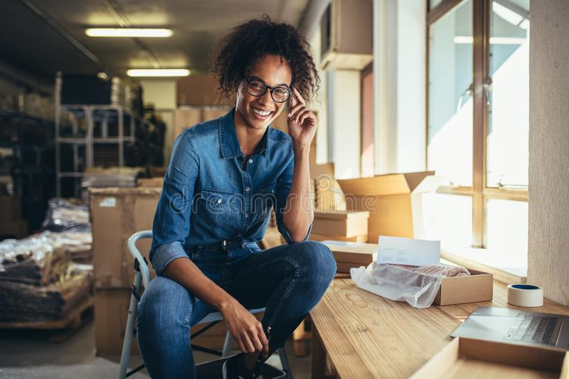 Confident businesswoman at online store stock images