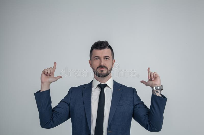 Confident young Caucasian man point with finger looking up demonstrating good advertising sale offer, excited European male in royalty free stock photos