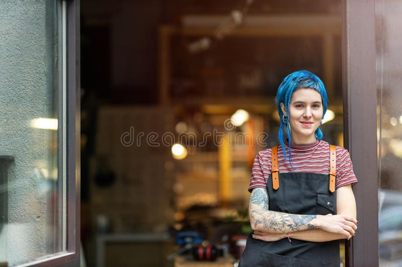 Confident young craftswoman in her workshop royalty free stock photography