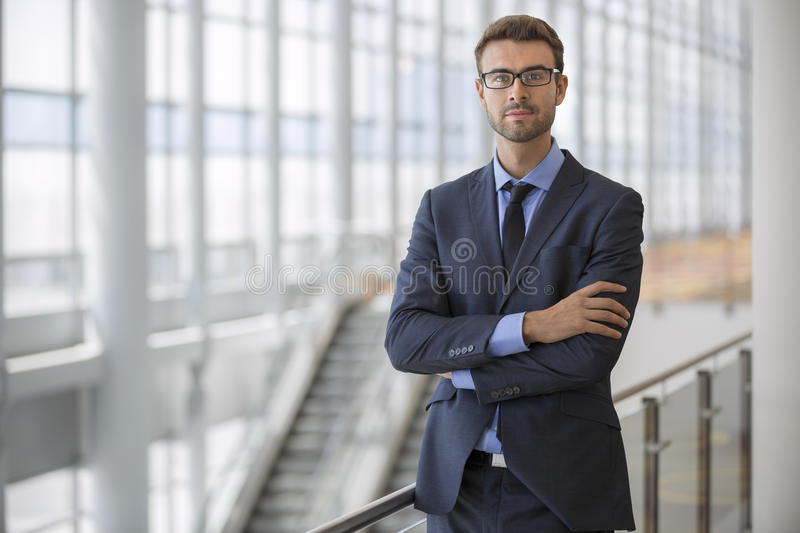 Download Confident Young Executive Arms Crossed Modern Architecture Escalator Office Building Stock Image - Image: 45584191