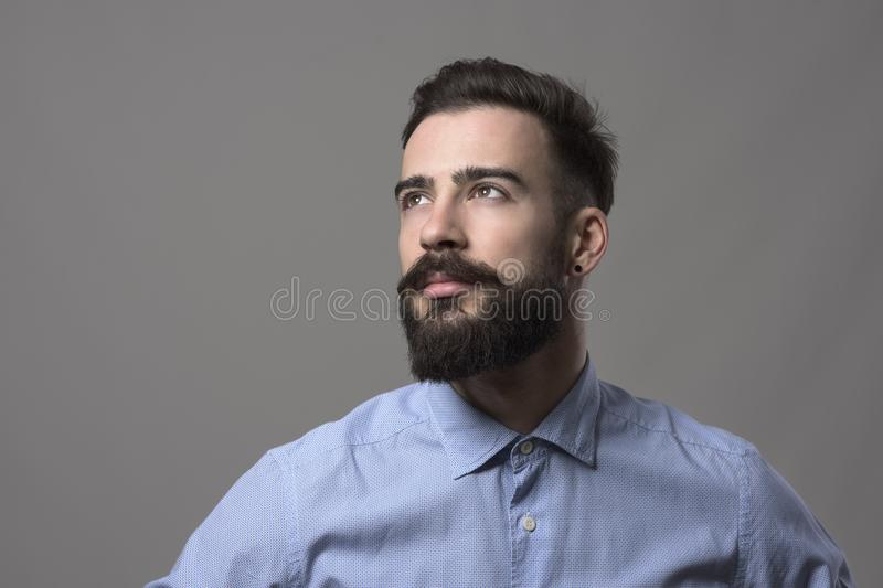 Confident young handsome stylish business man looking up at copyspace stock photos