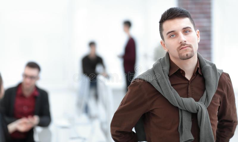 Confident young man in the background of the office. Confident young men in the background of the office. photo with copy space stock images