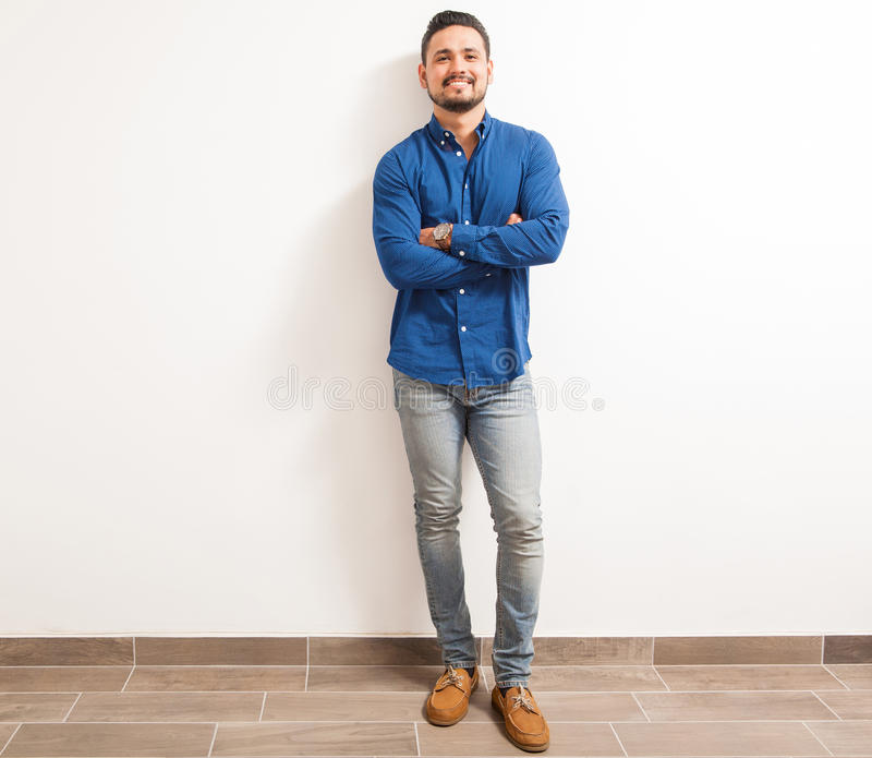 Confident young man with his arms crossed stock image