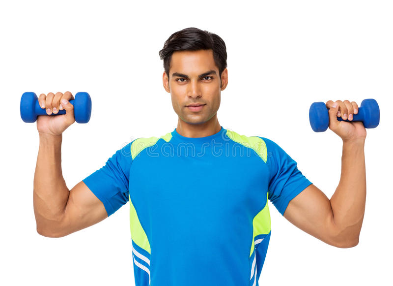 Confident Young Man Lifting Weights royalty free stock images