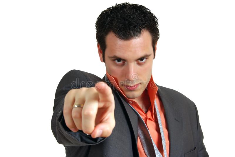Confident young man pointing finger stock image