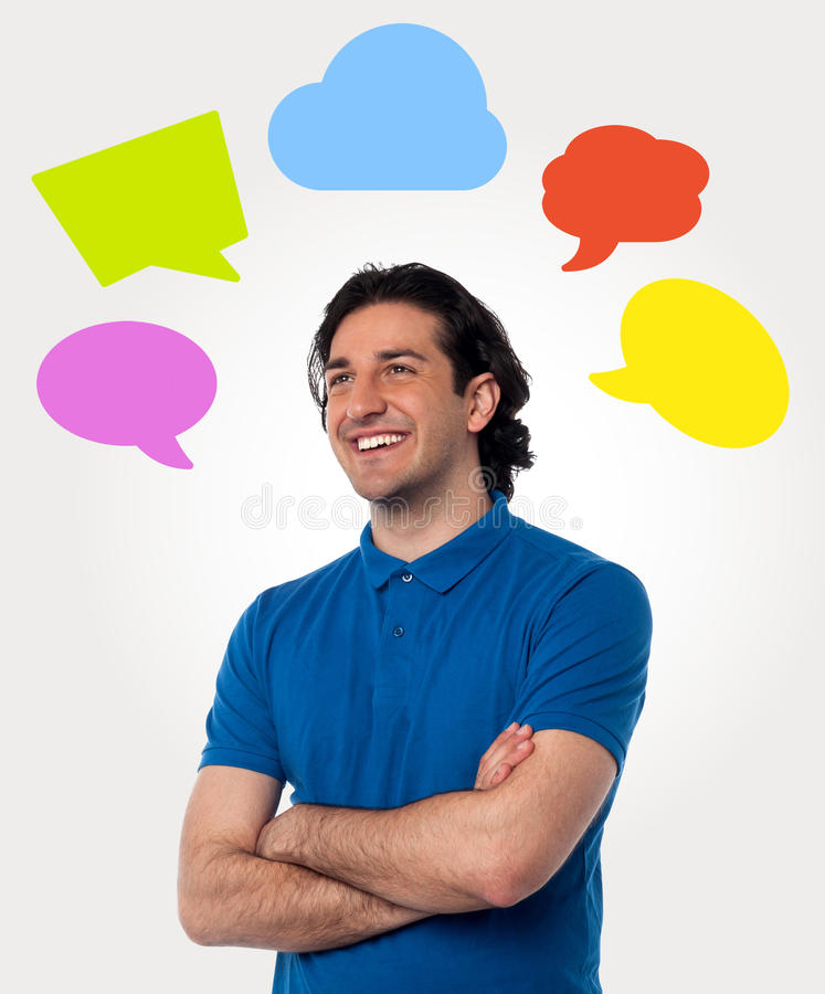 Confident young man with speech bubbles. Smiling thoughtful man with colorful speech bubbles vector illustration