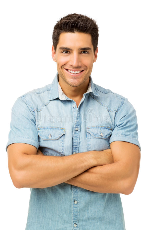 Confident Young Man Standing Arms Crossed stock photo
