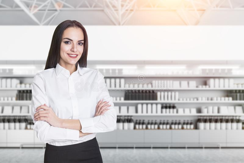 Confident businesswoman in mock up supermarket royalty free stock images