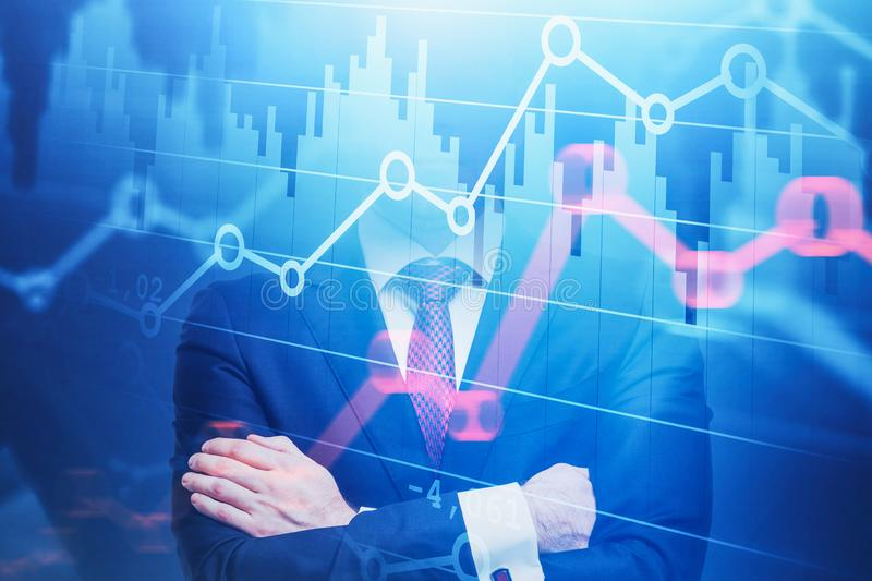 Confident trader and forex graphs. Confident young trader standing with crossed arms with double exposure of graphs. Concept of stock market. Toned image stock image