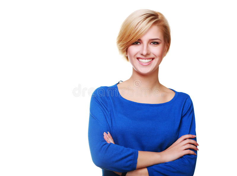 Confident young woman with arms folded isolated. On white background stock images