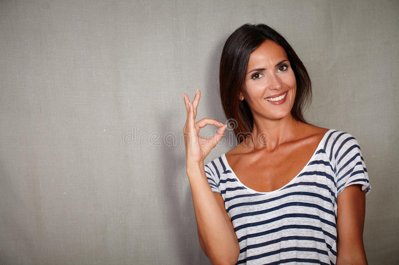 Confident young woman congratulating while smiling royalty free stock photo