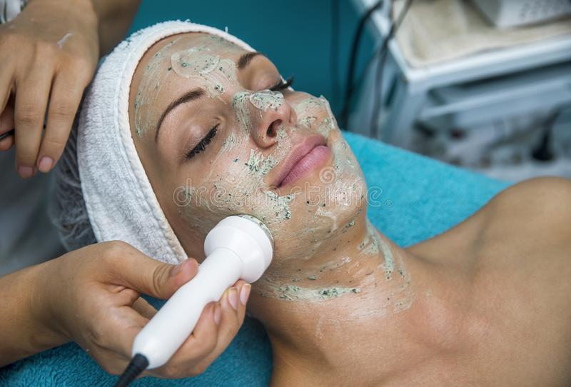 Beautiful woman at the beautician. royalty free stock photography