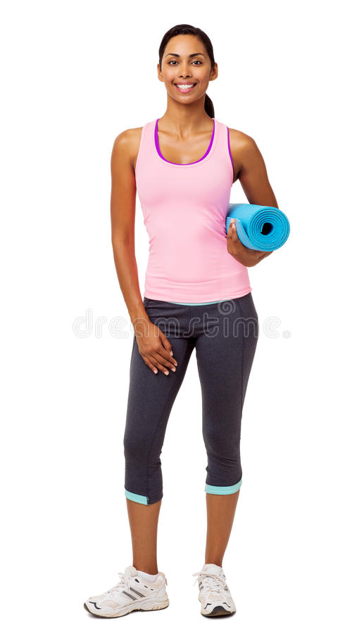 Confident Young Woman With Exercise Mat royalty free stock photography