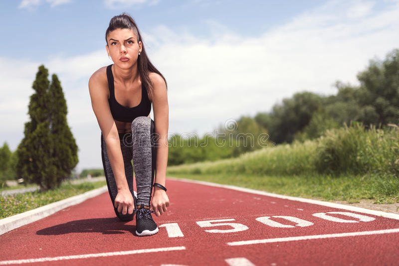 Download Confident Young Woman Getting Ready For Running Stock Photo