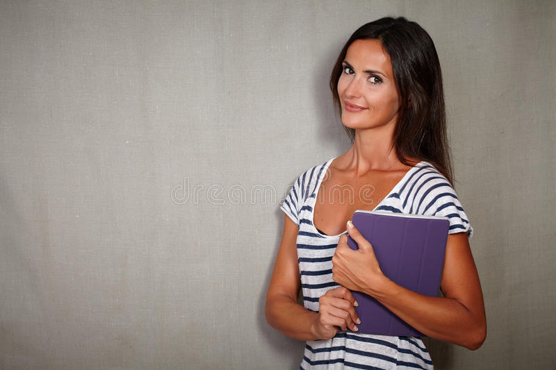 Confident young woman holding wireless tablet stock photography