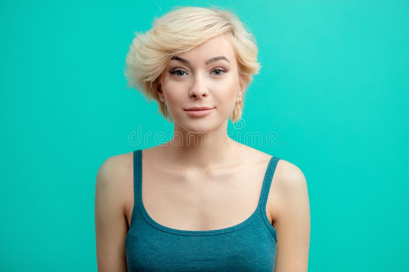 Confident young woman with pleasant appearance looking at the camera stock images
