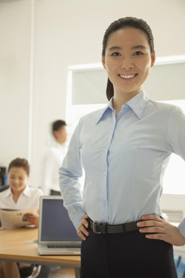 Free Confident Young Woman Smiling With Hands On Her Hips In The Office, Portrait Stock Photography - 31126932