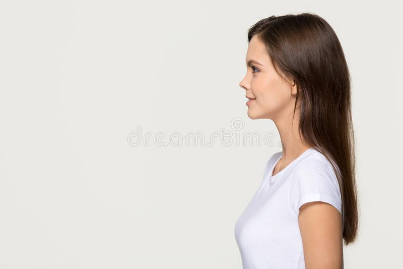 Confident young woman standing in profile looking forward at copyspace royalty free stock photo