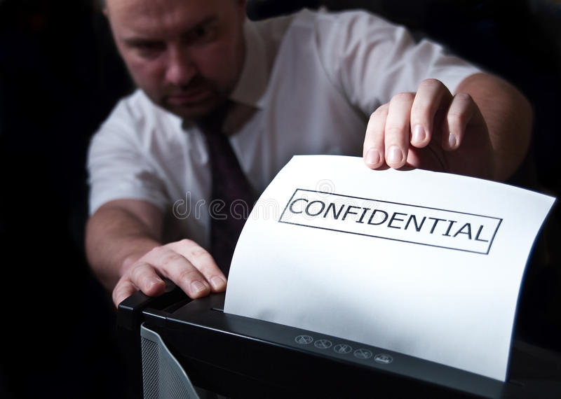 Confidential shredder stock photos