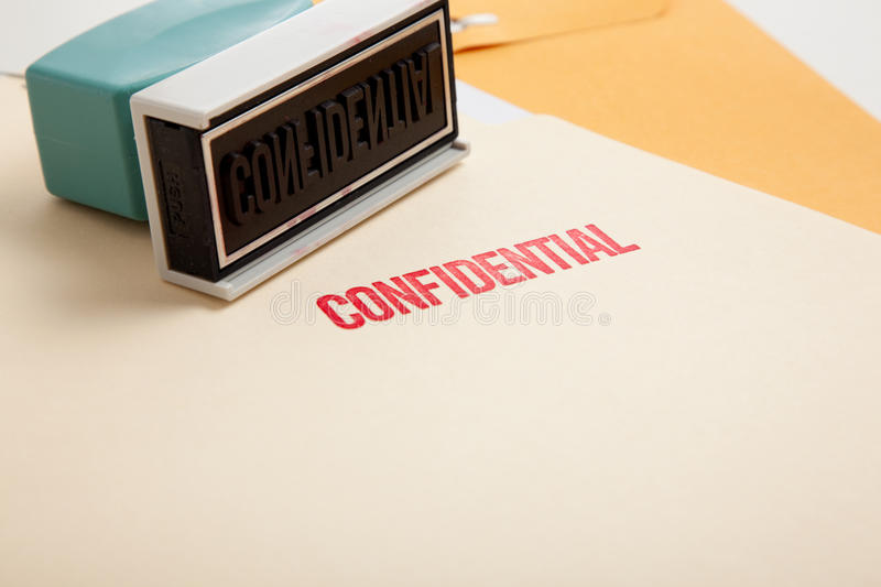 Confidential stamp on folders royalty free stock images