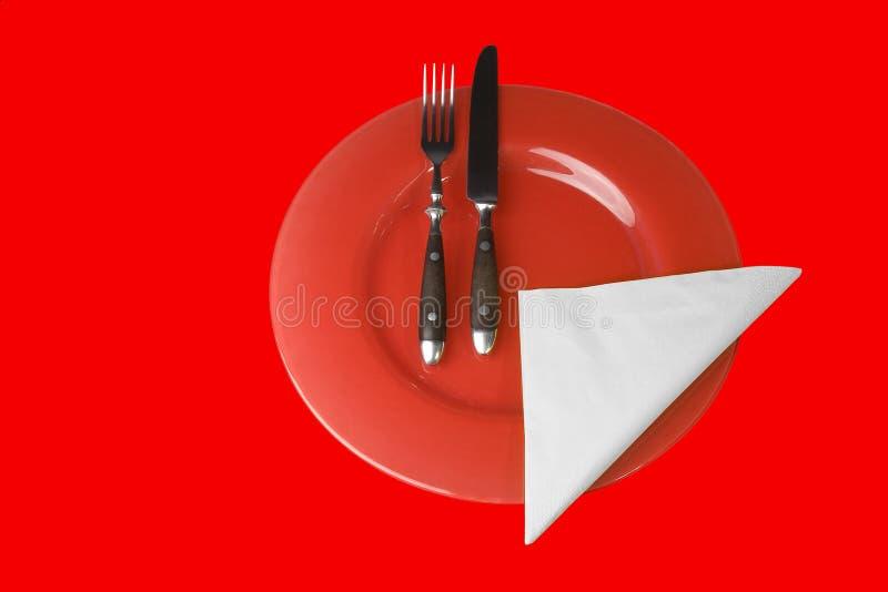 Configuración de lugar con la placa, la fork y el cuchillo fotografía de archivo libre de regalías