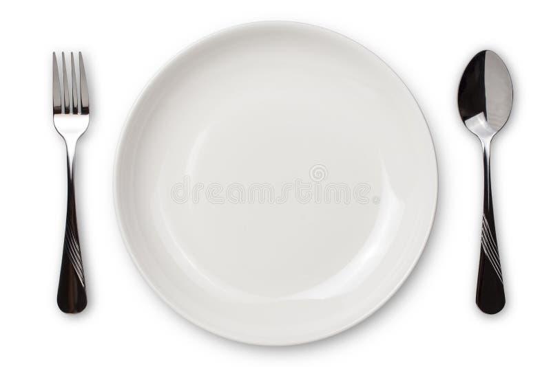Configuraci?n de lugar de la cena Una placa blanca con la bifurcaci?n de plata y cuchara aislada en el fondo blanco Visi?n desde  imagen de archivo libre de regalías