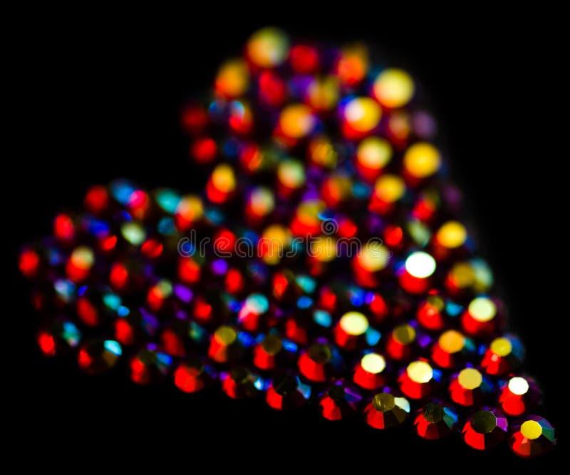 Configuration colorée de coeur de strass sur le noir photos libres de droits