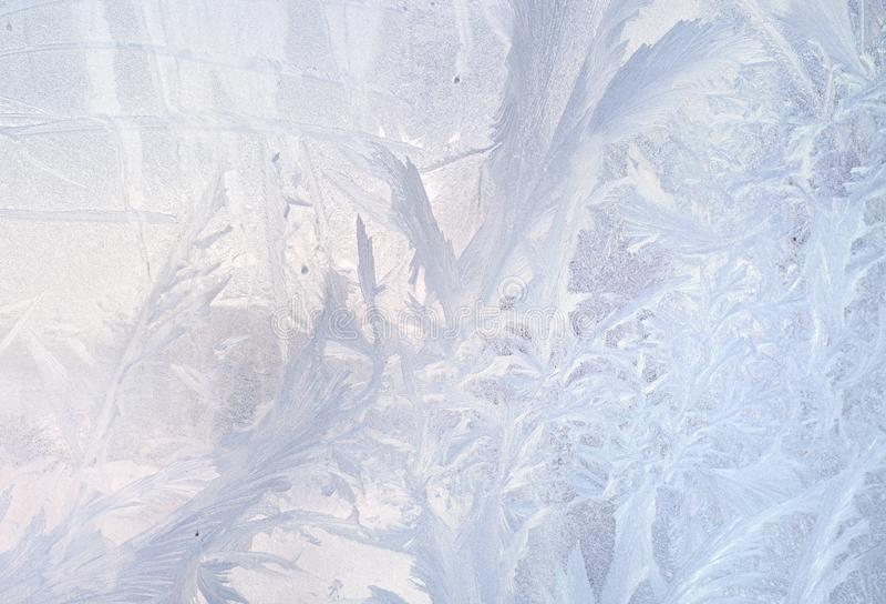 Configurations de glace sur la glace de l'hiver Fond congelé par Noël Hiver modifiant la tonalité l'effet image libre de droits
