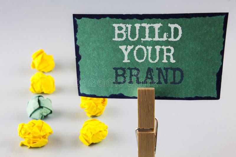 Configurazione di scrittura del testo della scrittura la vostra marca Il significato di concetto crea il vostro proprio modello d fotografia stock