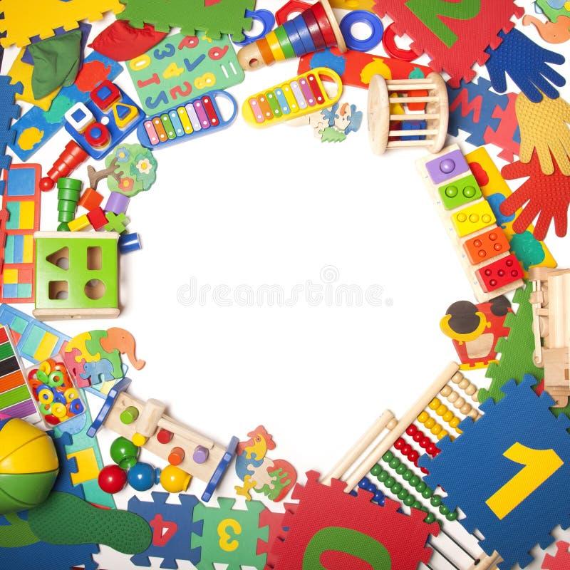 Confine di moltissimi giocattoli immagine stock libera da diritti