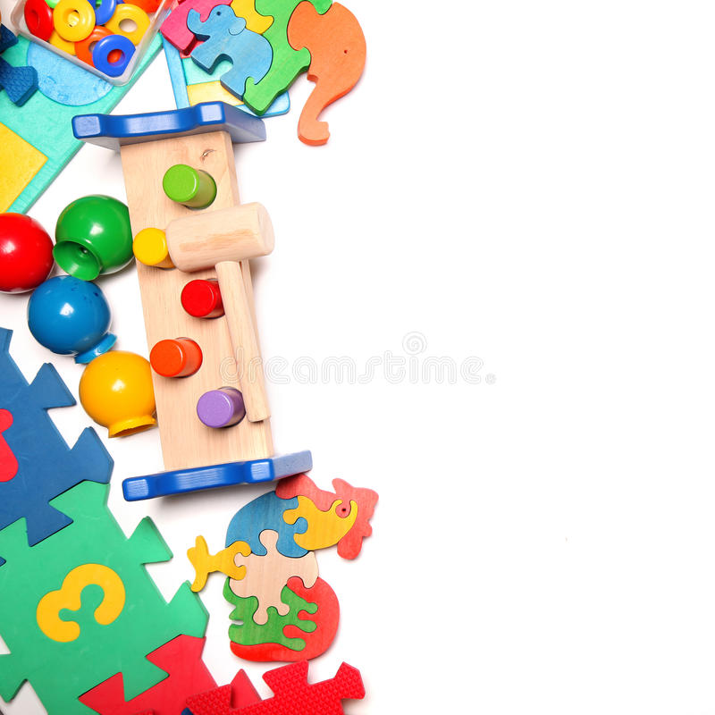Confine di moltissimi giocattoli immagine stock
