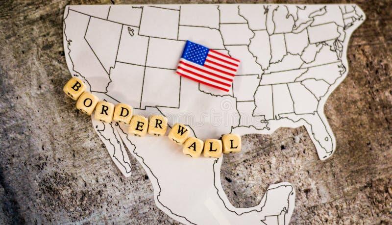 Confini il concetto di affari della parete con la mappa del Messico e degli Stati Uniti immagine stock