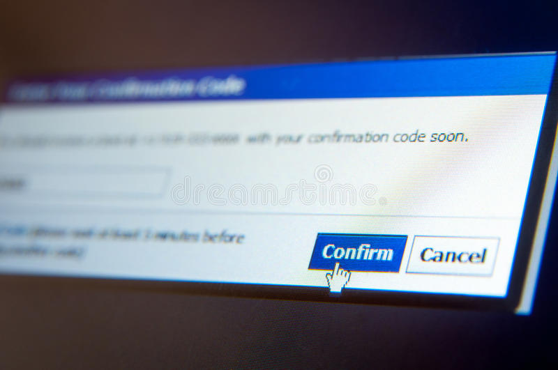 Confirm form. Mouse hand on confirm button on an lcd display royalty free stock photo