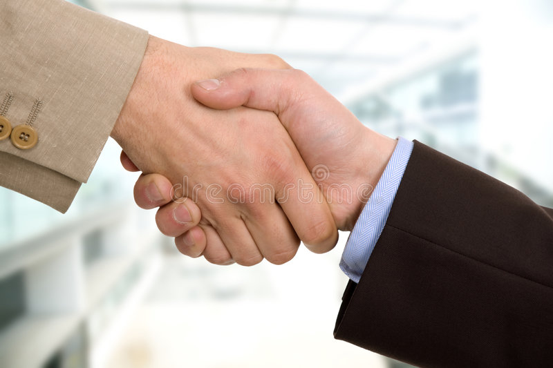 Confirmation. Business team hand shake at the office royalty free stock photo