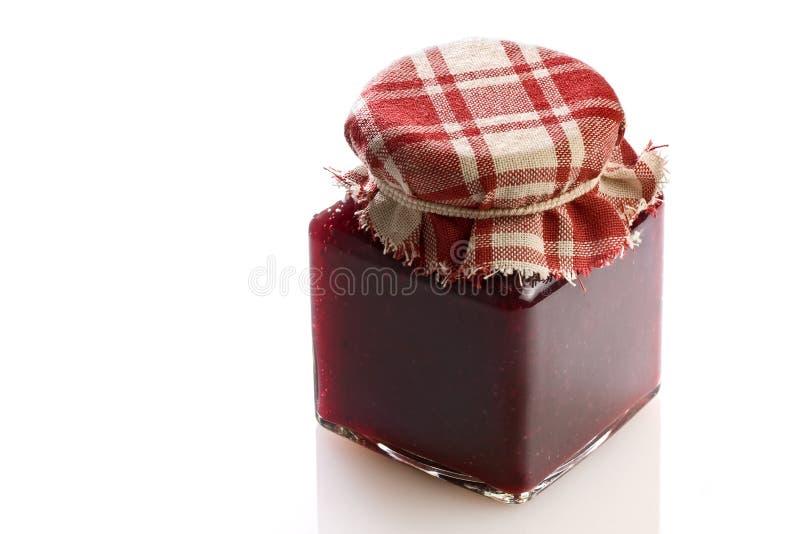 Pot de confiture de fraise photographie stock libre de droits