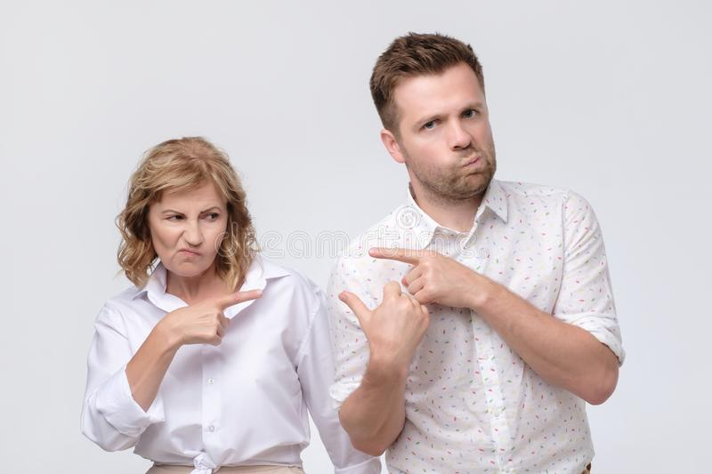 Conflict bad relationships. Two people pointing fingers at each other stock image