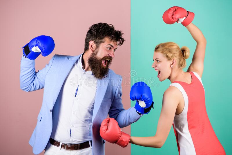 Conflict concept. Family quarrel. Boxers fighting in gloves. Domination concept. Gender battle. Gender equal rights royalty free stock images
