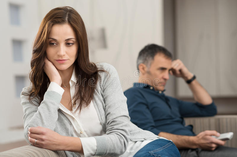 Conflict Between Couple. Sad Couple Sitting On Couch After Having Quarrel